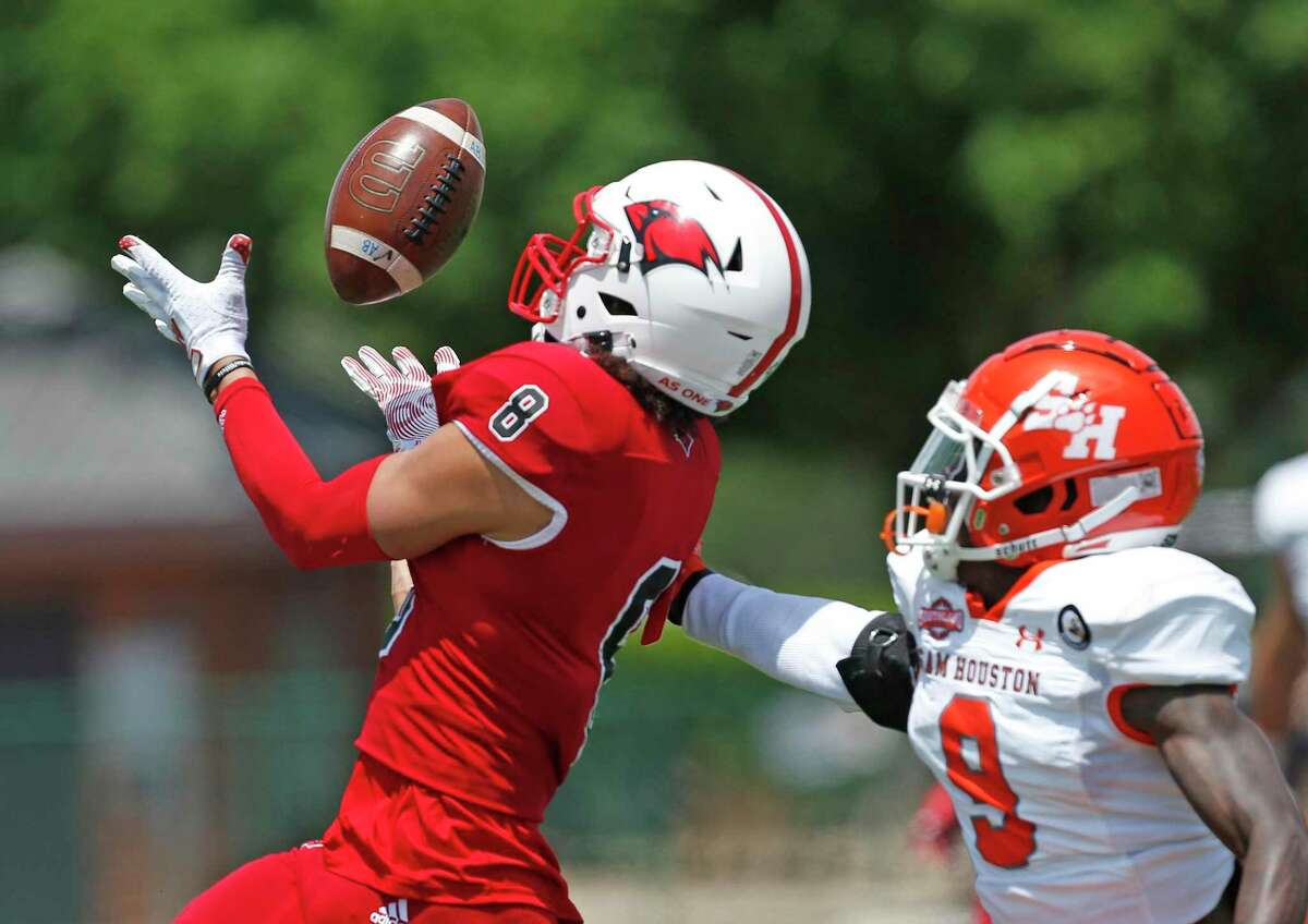 UIW Darion Chafin makes a reception by Sam Houston Jaylen Thomas. College Football UIW vs. Sam Houston on Saturday, April 17, 2021 at UIW.