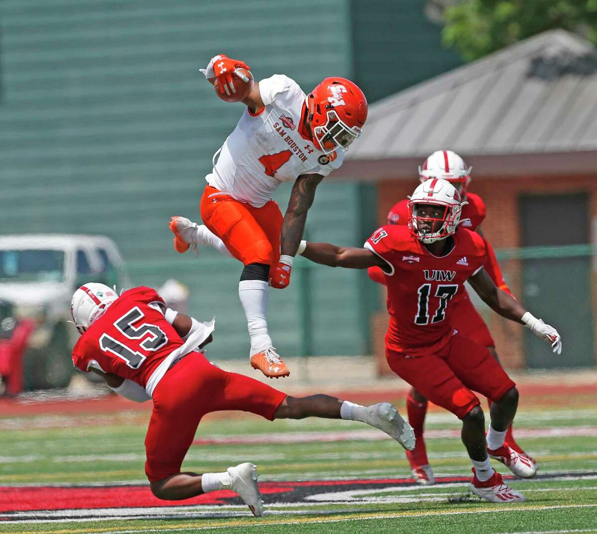 Sam Houston RB Ramon Jefferson leaps over UIW Shawn Holton. College Football UIW vs. Sam Houston on Saturday, April 17, 2021 at UIW.