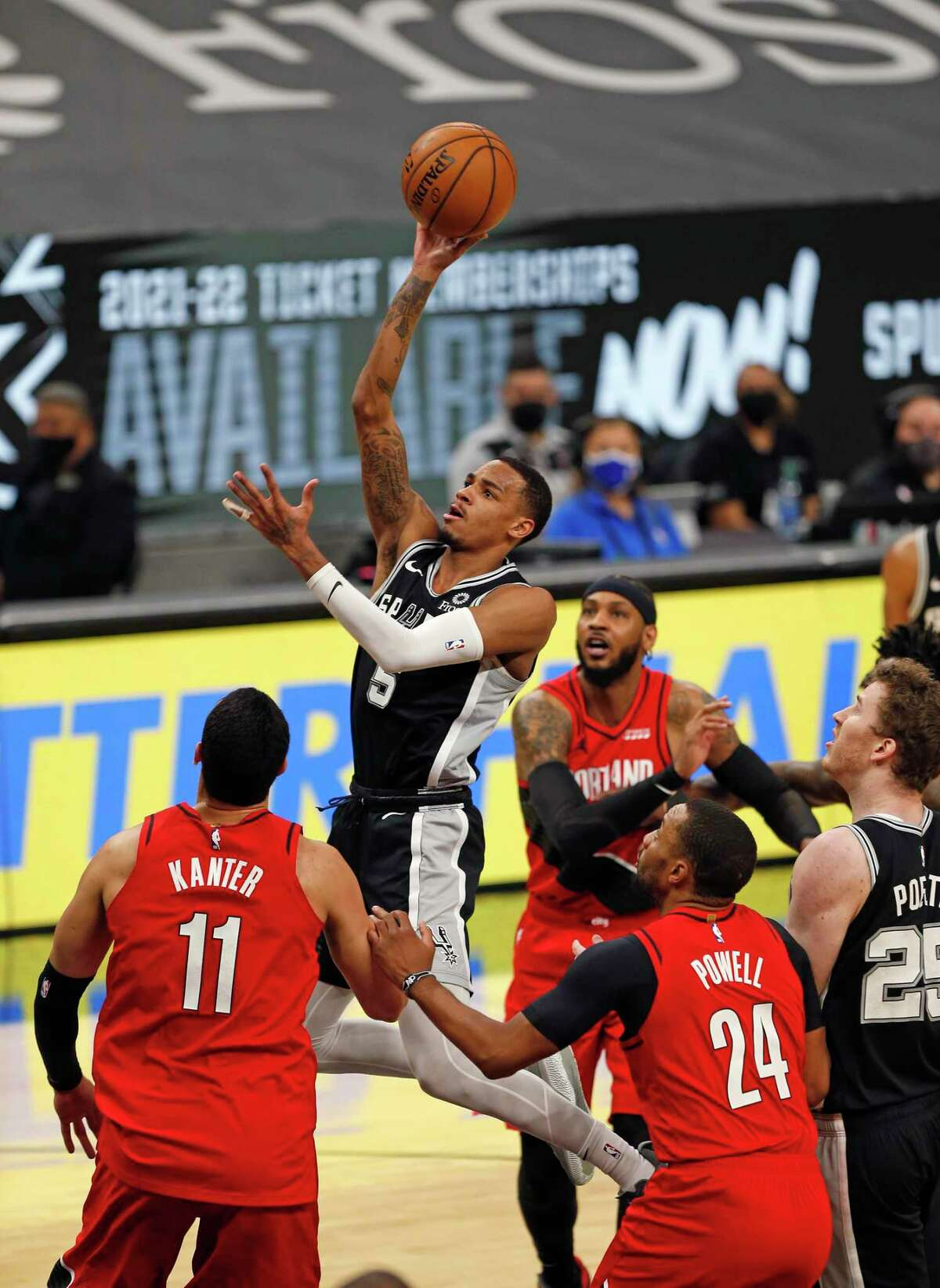 SAN ANTONIO, TX - APRIl 16: Dejounte Murray #5 of the San Antonio Spurs drives thru the Portland Trailblazers defense in the first half at AT&T Center on April 16, 2021 in San Antonio, Texas. NOTE TO USER: User expressly acknowledges and agrees that , by downloading and or using this photograph, User is consenting to the terms and conditions of the Getty Images License Agreement. (Photo by Ronald Cortes/Getty Images)