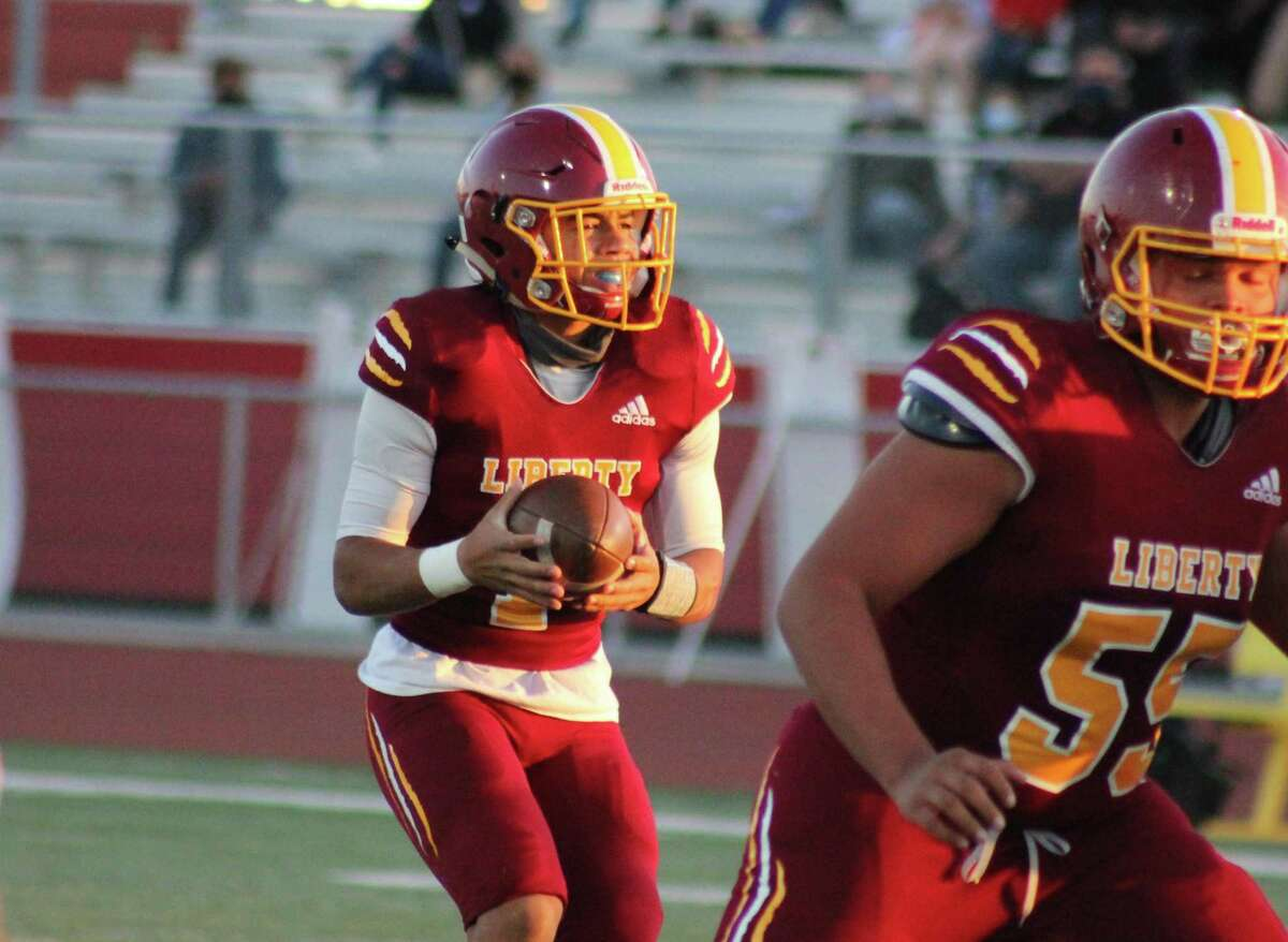 Liberty quarterback Nate Bell passed for 167 yards and a touchdown in a win over Heritage on Friday night.