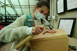 Leighton Murphy of Girl Scouts Troop 50398 builds a bat box for a project with the Rowayton Gardeners Friday at the Rowayton Community Center in Norwalk, Conn.