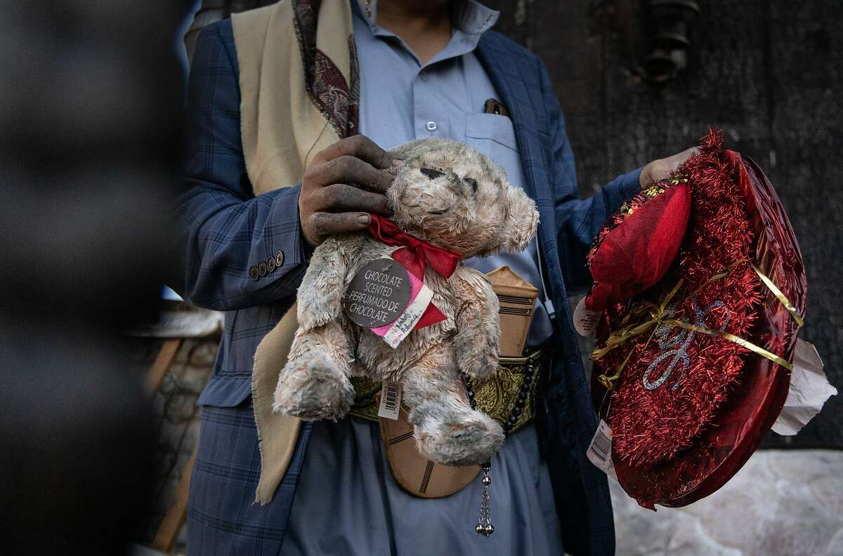 Abduh Alsamah holds the birthday presents of his 1-year-old niece, who died in the Oakland fire.