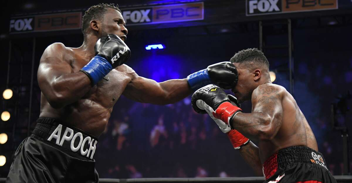 Efetobor Apochi (L) of Nigeria punches Deon Nicholson in the second round of a fight at the Shrine Auditorium and Expo Hall on April 17, 2021 in Los Angeles, California. (Photo by John McCoy/Getty Images)