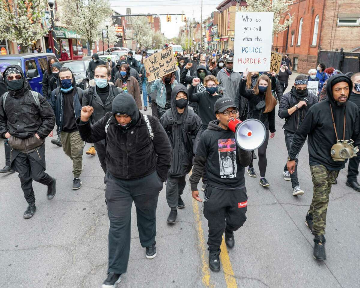 Black Lives Matter protesters walk through the streets of Albany, NY, to the South Station on Arch Street on Saturday, April 17, 2021. The march and protest were over the city's use of tear gas and other protocol used against people of color (Jim Franco/Special to the Times Union)