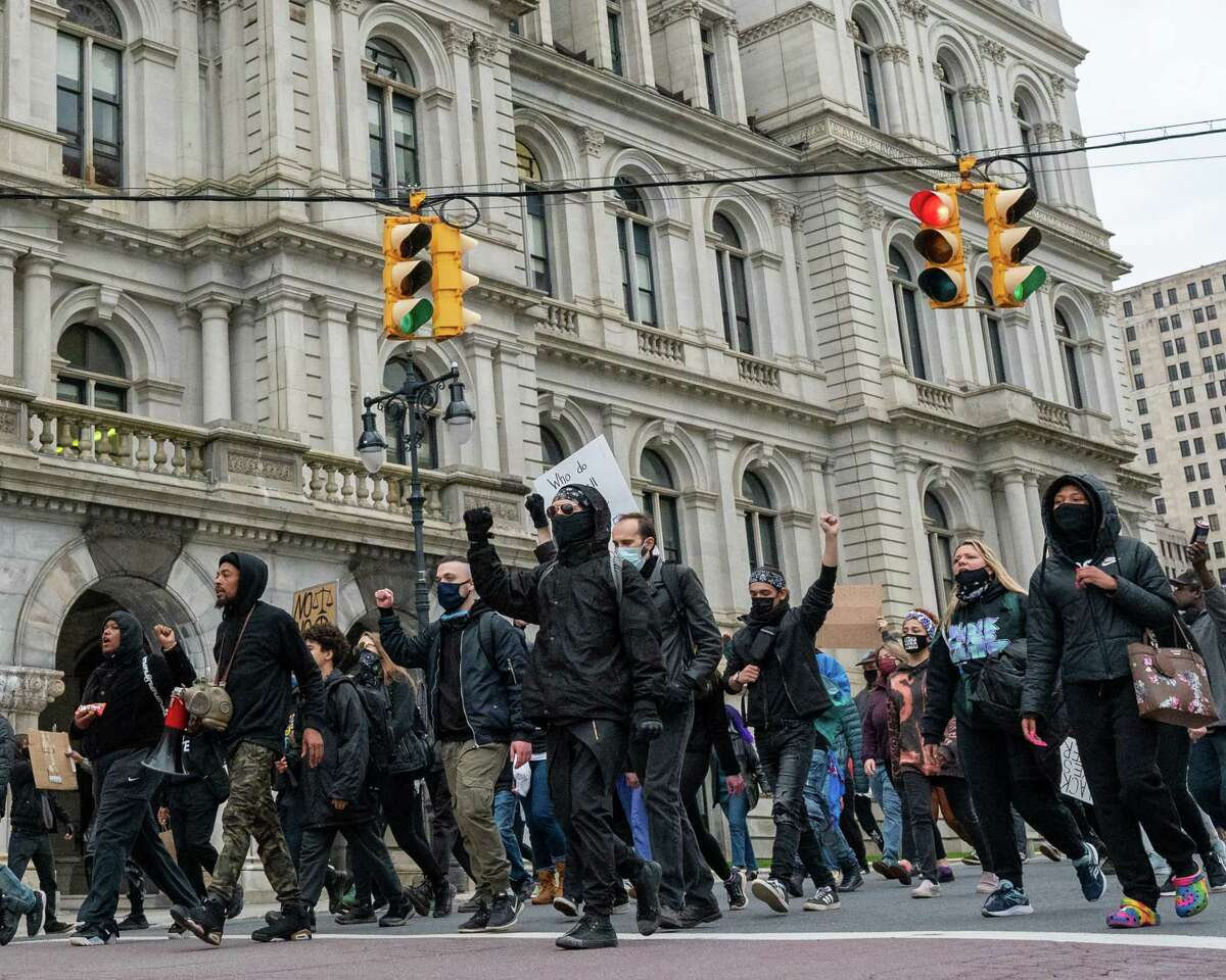 Black Lives Matter protesters walk past the state Capitol in Albany, NY, to the South Station on Arch Street on Saturday, April 17, 2021. The march and protest were over the city's use of tear gas and other protocol used against people of color (Jim Franco/Special to the Times Union)