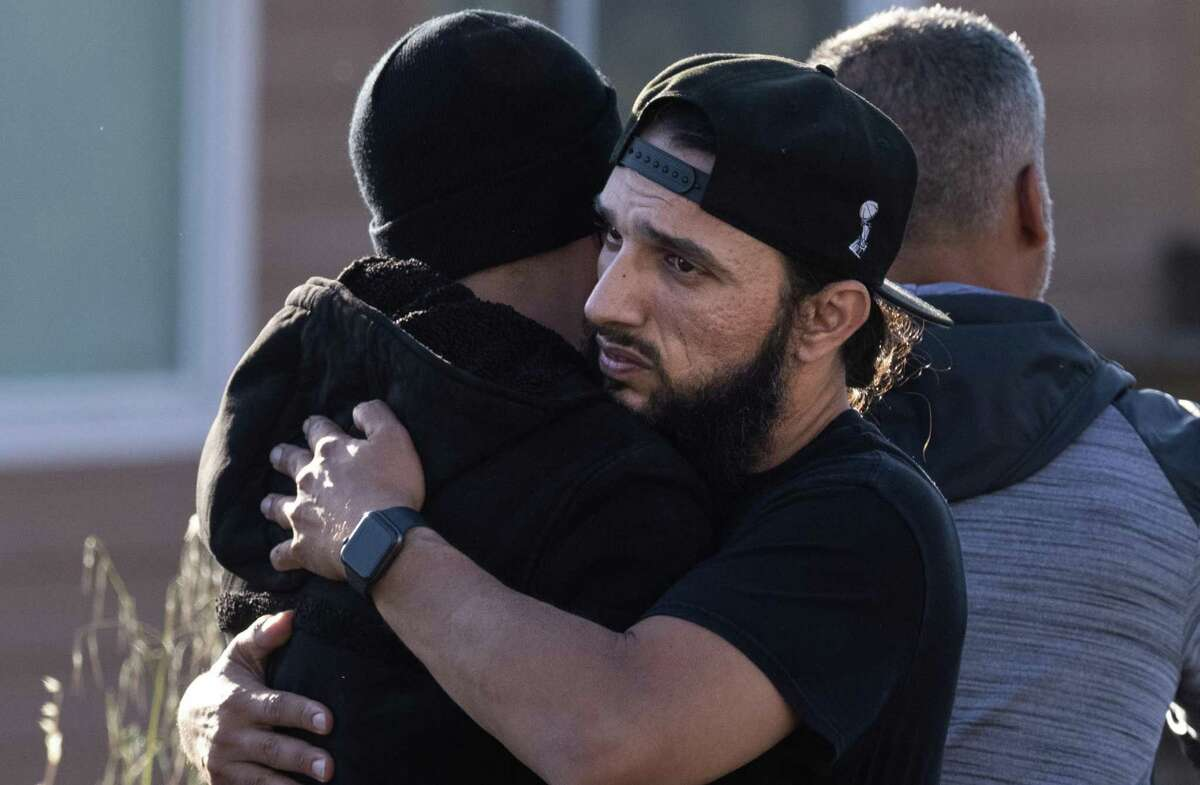 Ali Ahmed (left), a friend, hugs Safin Mobarez, whose brother-in-law and niece died in a house fire in Oakland in April. Arson was suspected in the blaze.