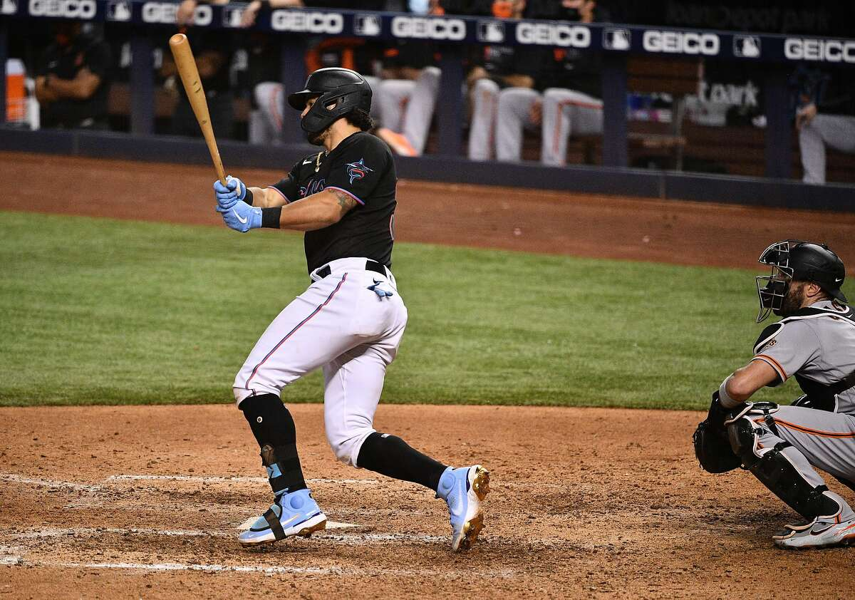MIAMI, FLORIDA - APRIL 17: Jorge Alfaro #38 of the Miami Marlins hits a walk off single for two rbi's to defeat the San Francisco Giants In the tenth inning at loanDepot park on April 17, 2021 in Miami, Florida. (Photo by Mark Brown/Getty Images)