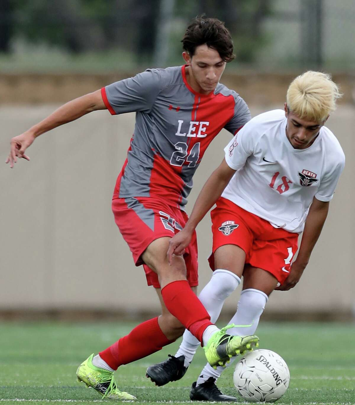 SA Lee's Julian Sanchez (24) and Rockwall-Heath's Luis Soto (18) struggle for control of the ball during their UIL 6A boys State championship soccer game at Birkelbach Field on April 17, 2021 in Georgetown, Texas.
