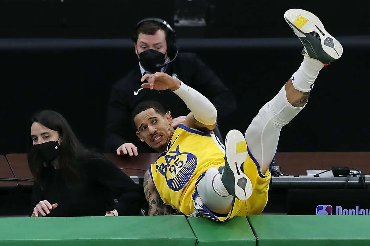 Golden State Warriors' Juan Toscano-Anderson goes out of bounds after chasing the ball during the second half of an NBA basketball game against the Boston Celtics, Saturday, April 17, 2021, in Boston. (AP Photo/Michael Dwyer)
