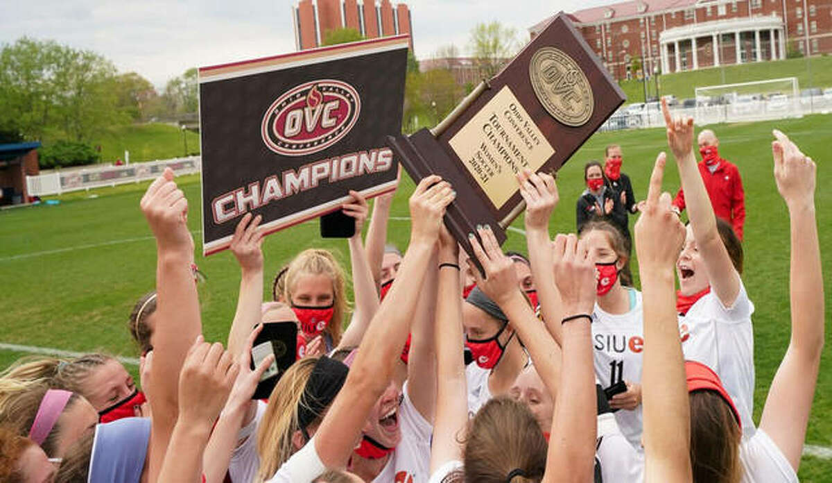 The SIUE women's soccer team celebrates with the Ohio Valley Conference championship plaque after a 2-1 win over SEMO on Saturday in Murray, Kentucky.
