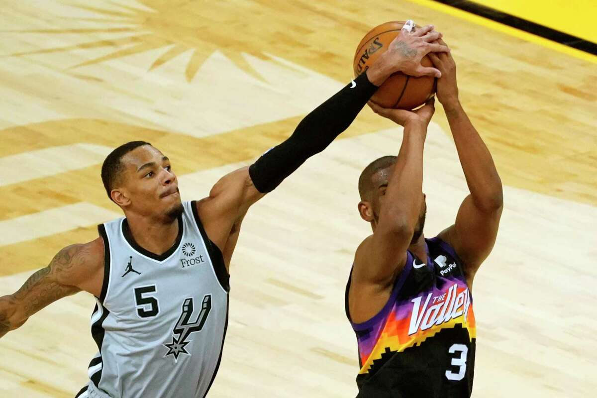 Spurs guard Dejounte Murray (5) during the first half of an NBA basketball game against the Phoenix Suns, Saturday, April 17, 2021, in Phoenix.