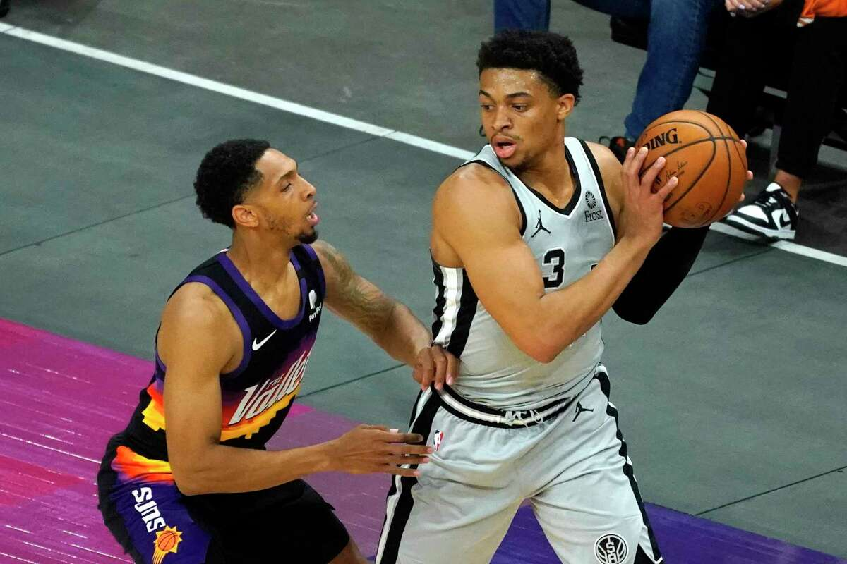Spurs forward Keldon Johnson (3) during the first half of an NBA basketball game against the Phoenix Suns, Saturday, April 17, 2021, in Phoenix.
