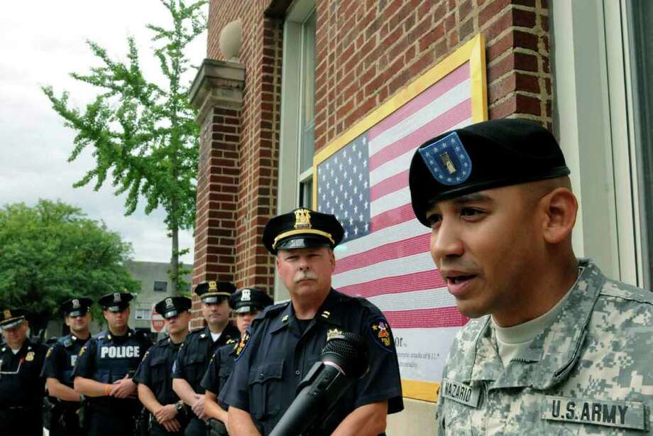 Iraq war veteran U.S. Army 1st Lt. Carlos Nazario, a Troy police officer, speaks during a 911 attacks remembrance ceremony at Troy Police headquarters. ( Michael P. Farrell / Times Union ) Photo: Michael P. Farrell