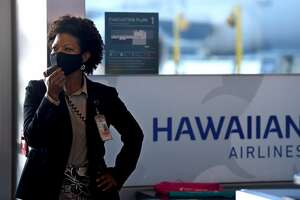 """LONG BEACH, CA - MARCH 10: Cynthia Guidry, Director of the Long Beach Airport, welcomes travelers and staff of Hawaiian Airlines on Hawaiian Airlines""""u2019 inaugural service to Maui""""u2019s Kahului Airport in Long Beach on Wednesday, March 10, 2021. (Photo by Brittany Murray/MediaNews Group/Long Beach Press-Telegram via Getty Images)"""