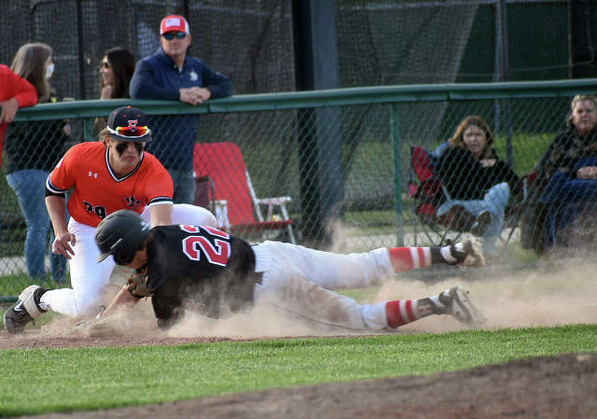 In this file photo, Edwardsville third baseman Spencer Stearns tags out a Highland runner on Thursday. On Saturday, Stearns finished the two games 3 for 6 with a home run and five RBIs. He also struck out the side in a scoreless inning of relief against Normal West.