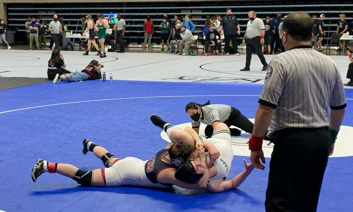 Tompkins' Kaitlyn Bryant and Clear Falls' Camryn Tresler compete for the 165-pound championship at the Region III-6A tournament April 17 at Merrell Center.