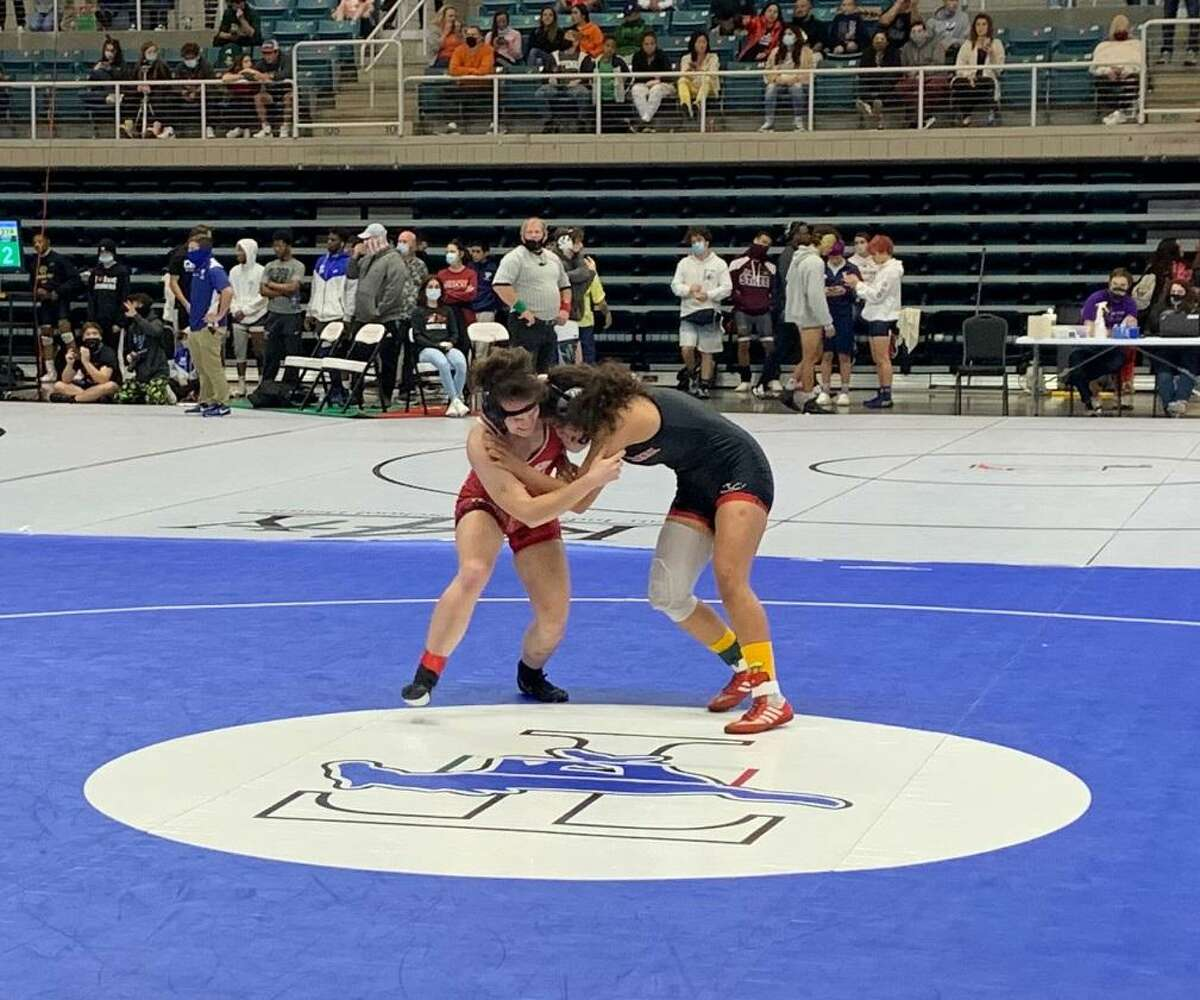 Langham Creek's Diriann Porras and Katy's Graycen Hall compete for the 138-pound championship at the Region III-6A tournament April 17 at Merrell Center.