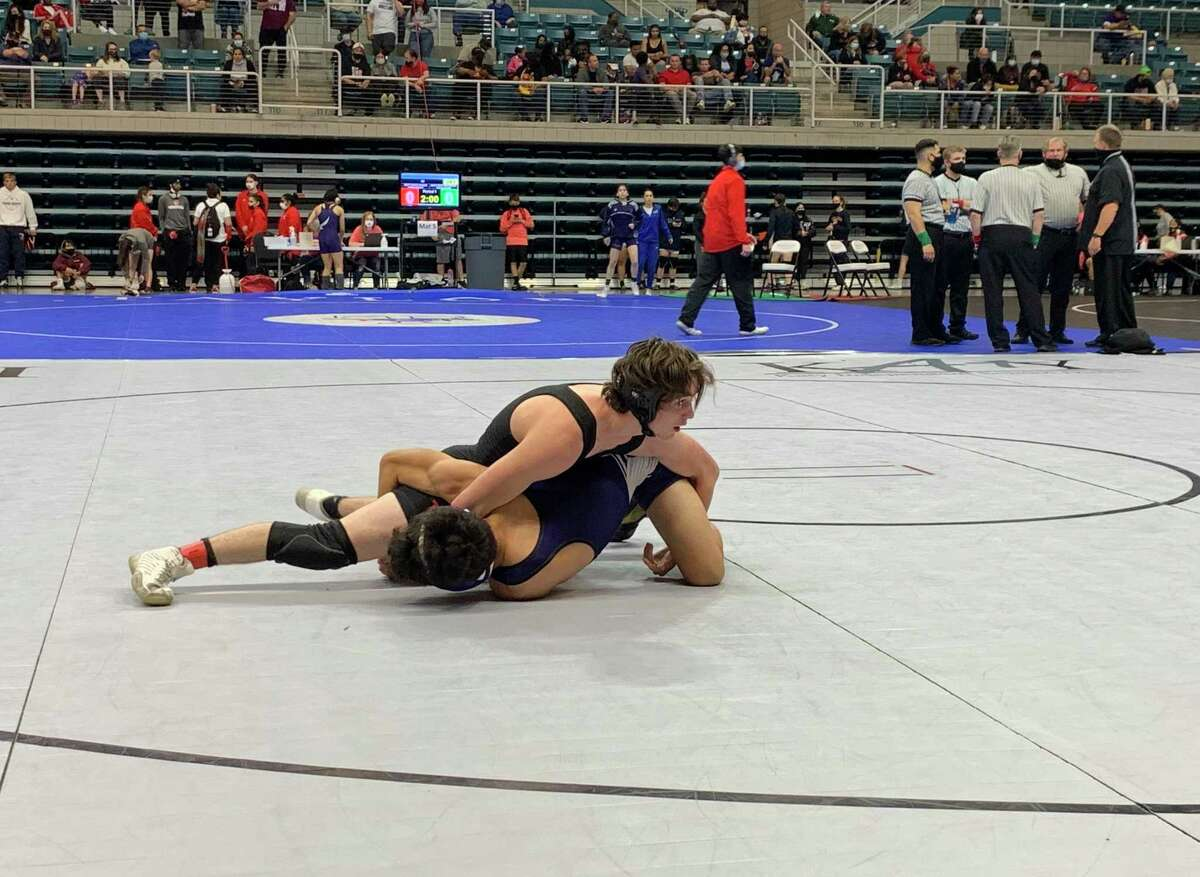 Katy's Jackson Crandall and Morton Ranch's Ruben Moreno compete for the 126-pound championship at the Region III-6A tournament April 17 at Merrell Center.