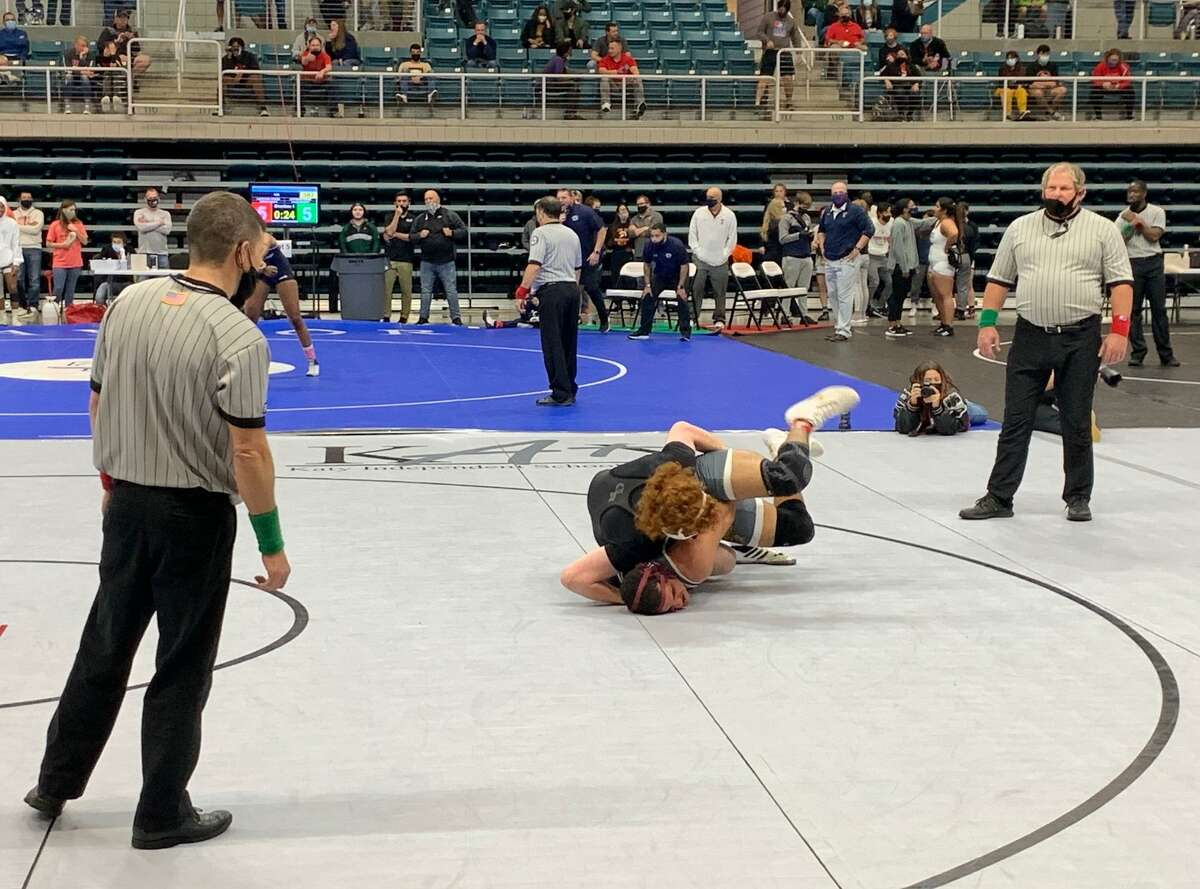 George Ranch's Luke Marvin and Cinco Ranch's Lane Staton compete for the 182-pound championship at the Region III-6A tournament April 17 at Merrell Center.