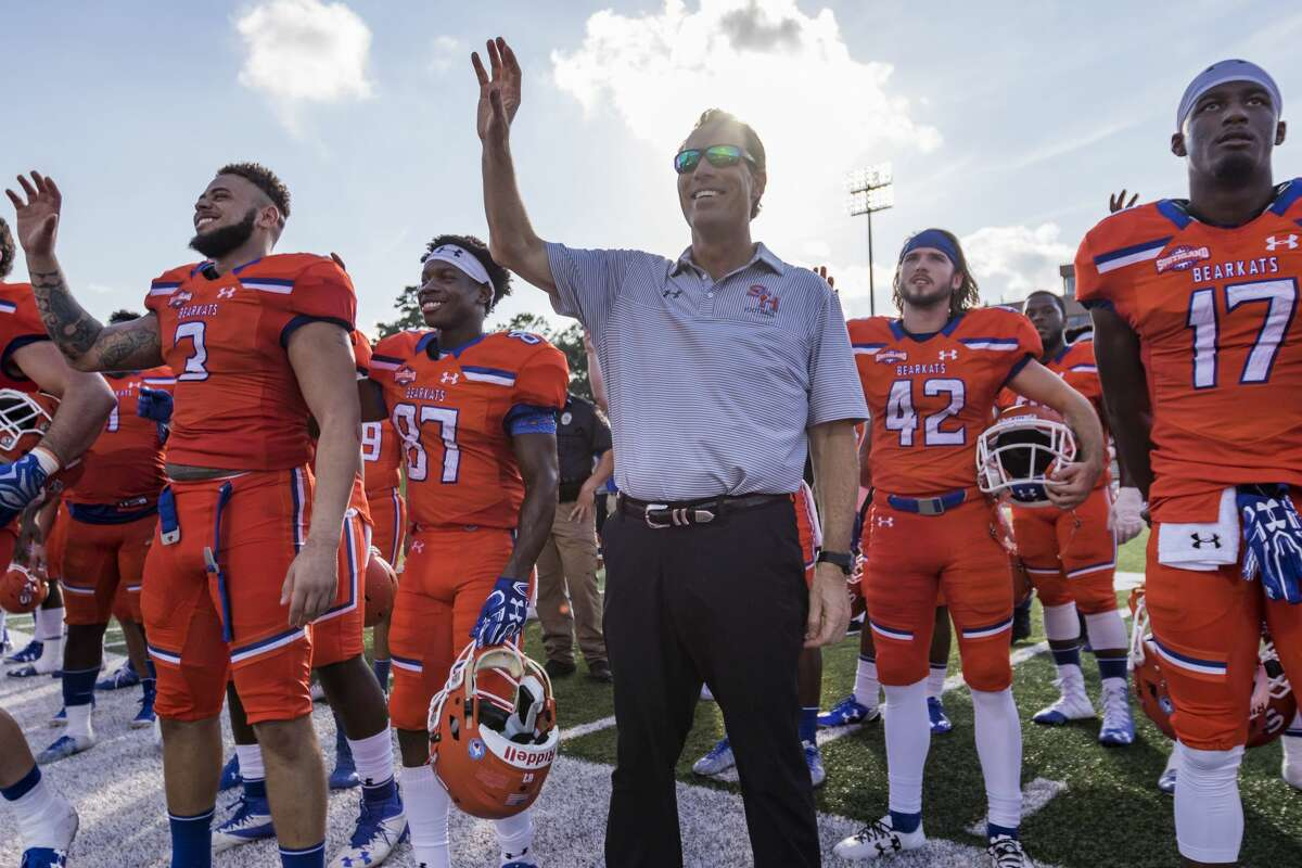 Sam Houston State head coach K.C. Keeler and team sing the school fight song after an NCAA college football game Saturday, Nov. 4, 2017, in Huntsville, Texas. Sam Houston State defeated Incarnate Word 57-20. (AP Photo/Joe Buvid)