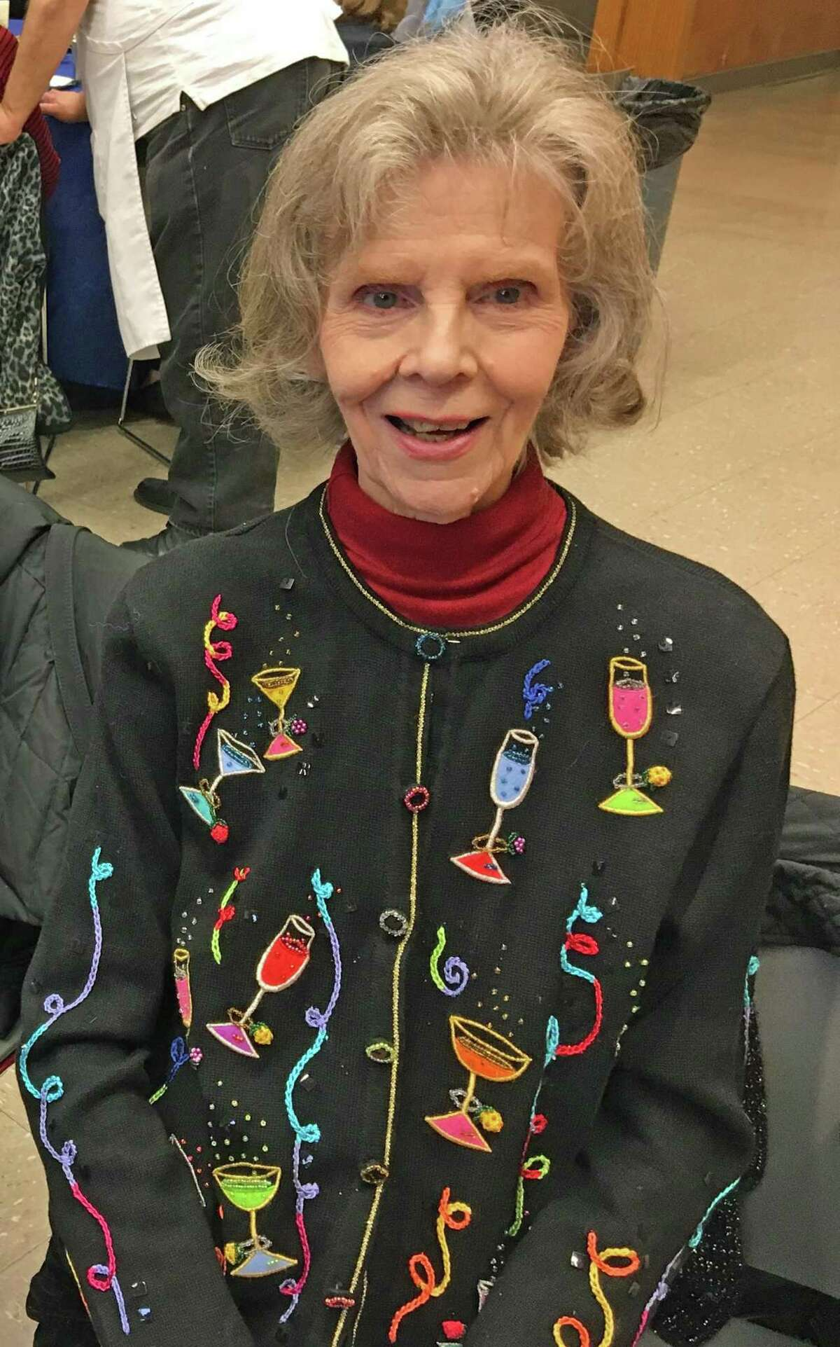 Gloria Mallozzi, 85 of Stamford, poses for a photo at a New Year's holiday party for older adults. One year into the pandemic, she reflected, and said positivity helped her get through the trials and tribulations.