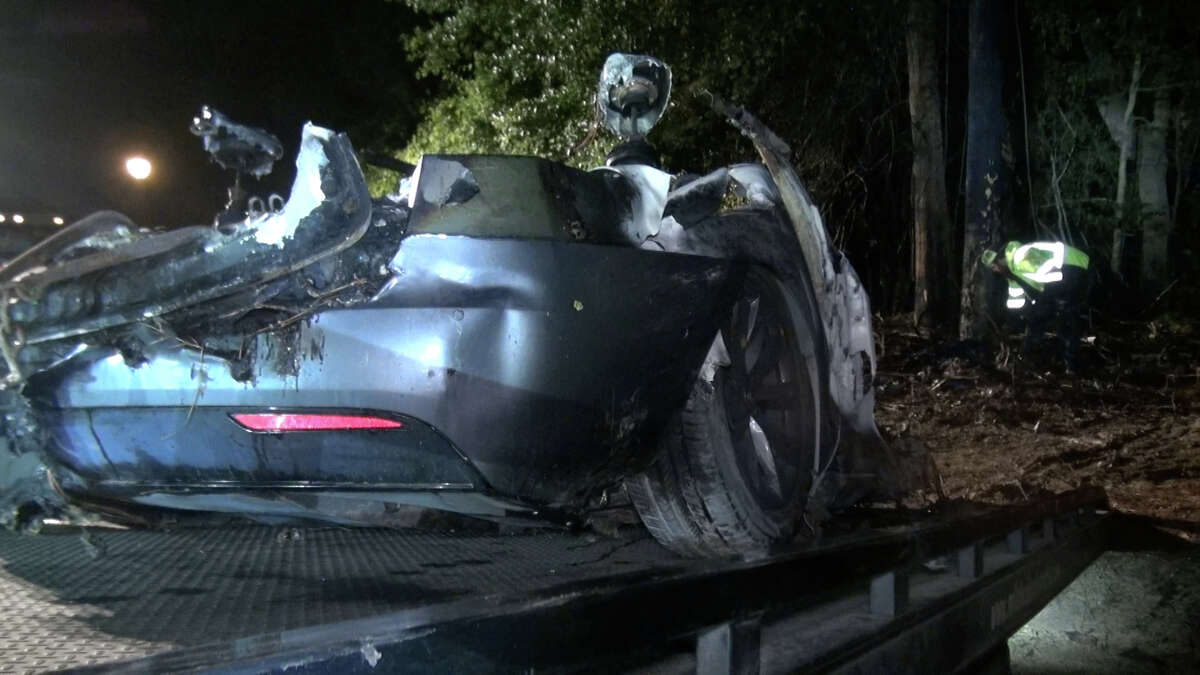 Two people died in a car fire Saturday night, according to the Woodlands Fire Department.