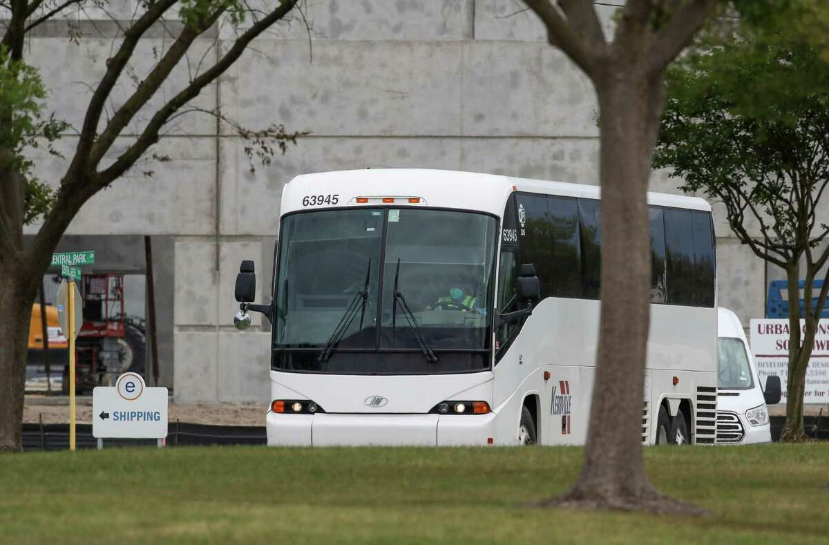 Teenage migrant girls are transported out of the National Association of Christian Churches facility in buses on Saturday, April 17, 2021, in Houston.