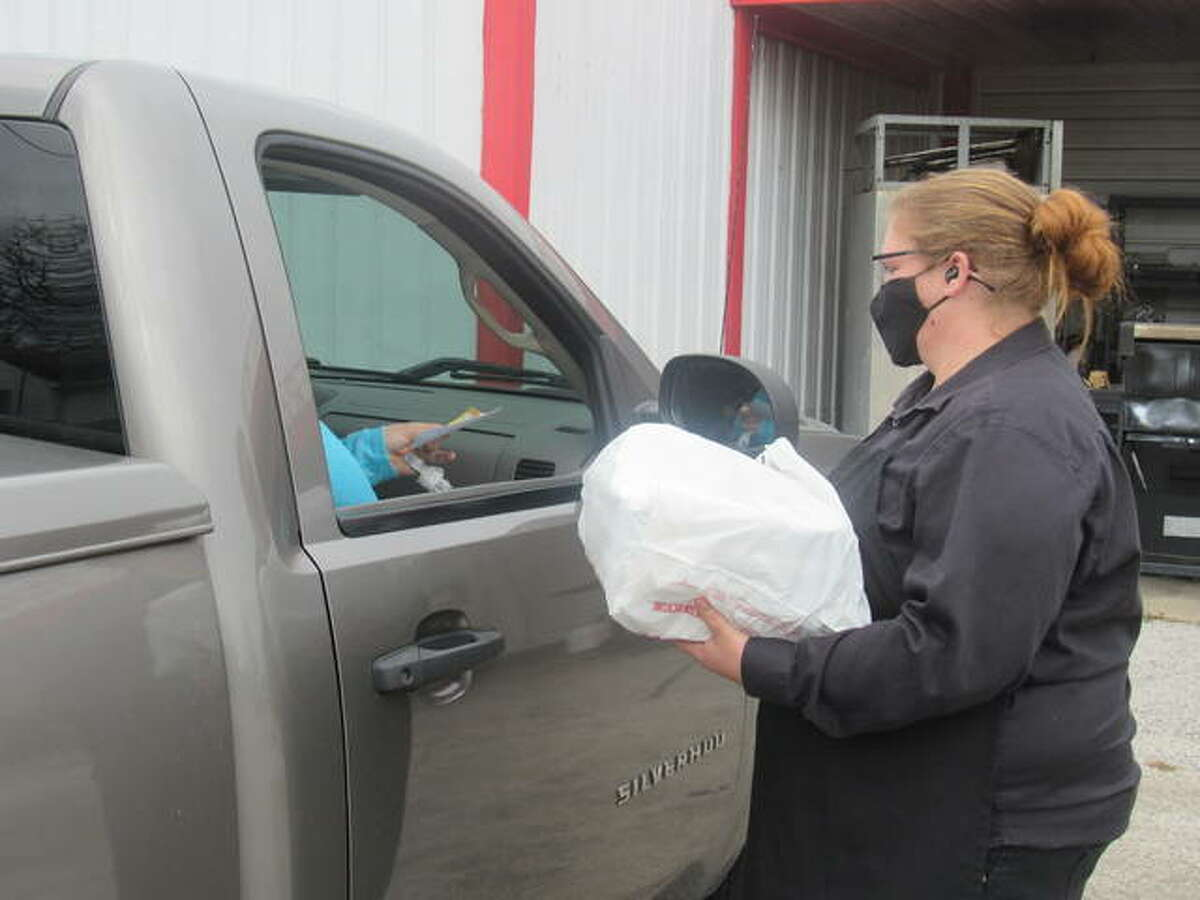 Ashley Wilkerson, a Chef Bob's Catering employee, delivers a meal to a Foundation Recovery Systems family on Friday.