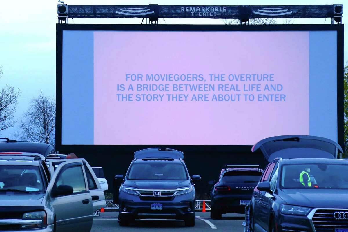 """A message for viewers at the new, larger screen at the Remarkable Theater's drive-in showing of """"Goonies"""" on Friday, April 16, 2021, in Westport, Conn."""