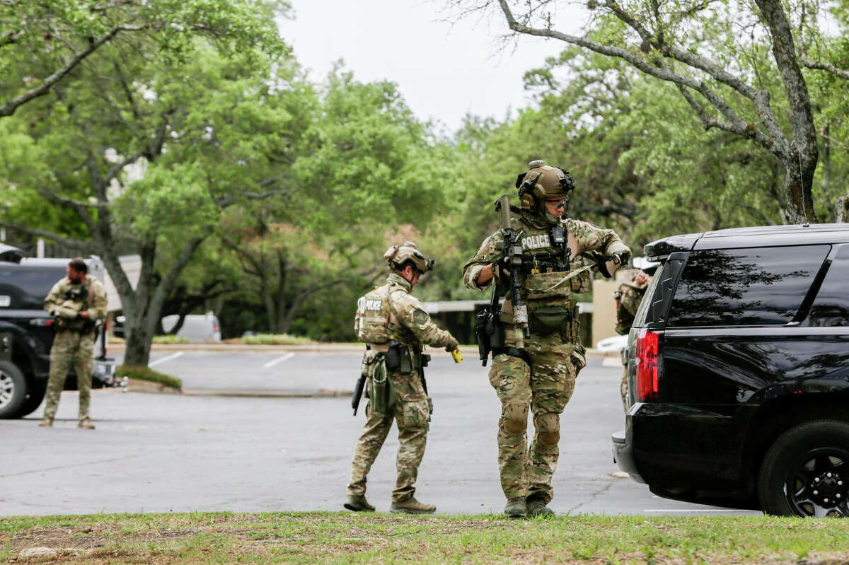 Austin police, SWAT and medical personnel respond to an active shooter situation located Great Hills Trail in Northwest Austin, Texas, on Sunday, April 18, 2021. Emergency responders say several people have been fatally shot in Austin and that no suspect is in custody. (Brontë Wittpenn/Austin American-Statesman via AP)
