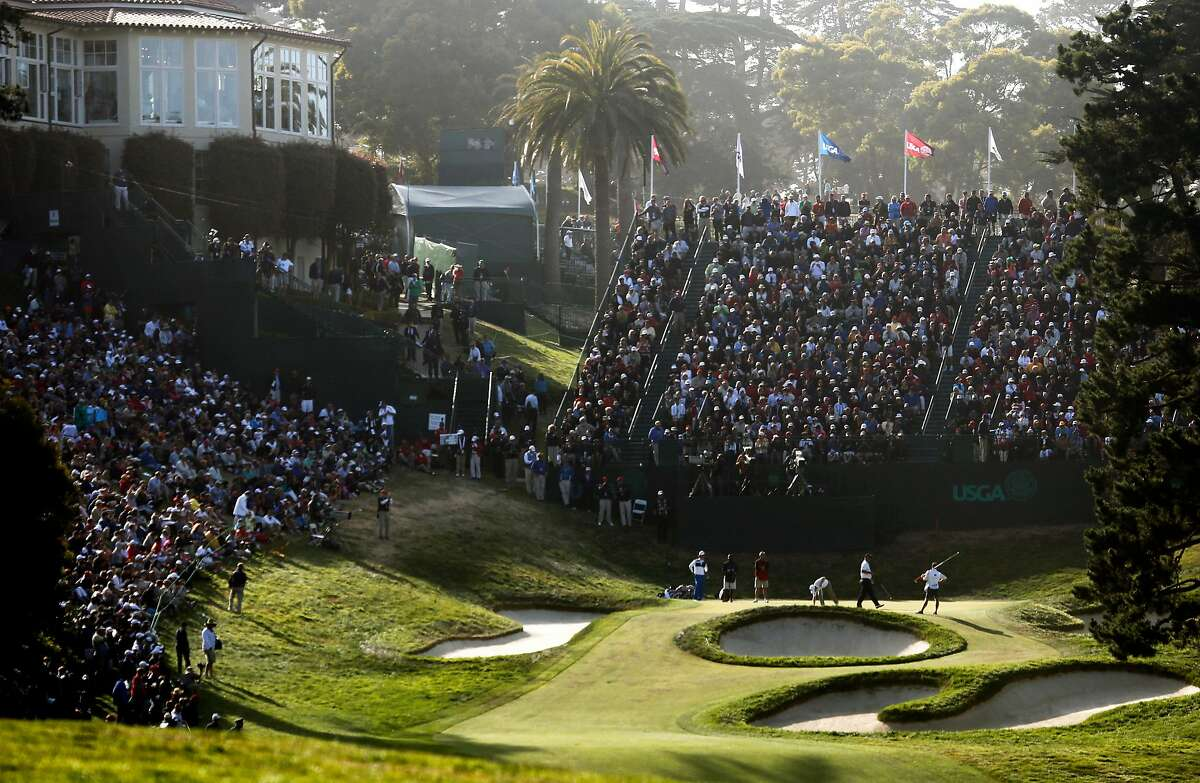 Fans packed the grandstand behind the 18th green during the second round of the 2012 U.S. Open at The Olympic Club. There will be no grandstands on the Lake Course for the Women's Open in June, because of the coronavirus pandemic.