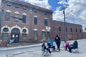 A handful of activists were stationed outside of the Albany Police Department South Station on April 18, 2021.