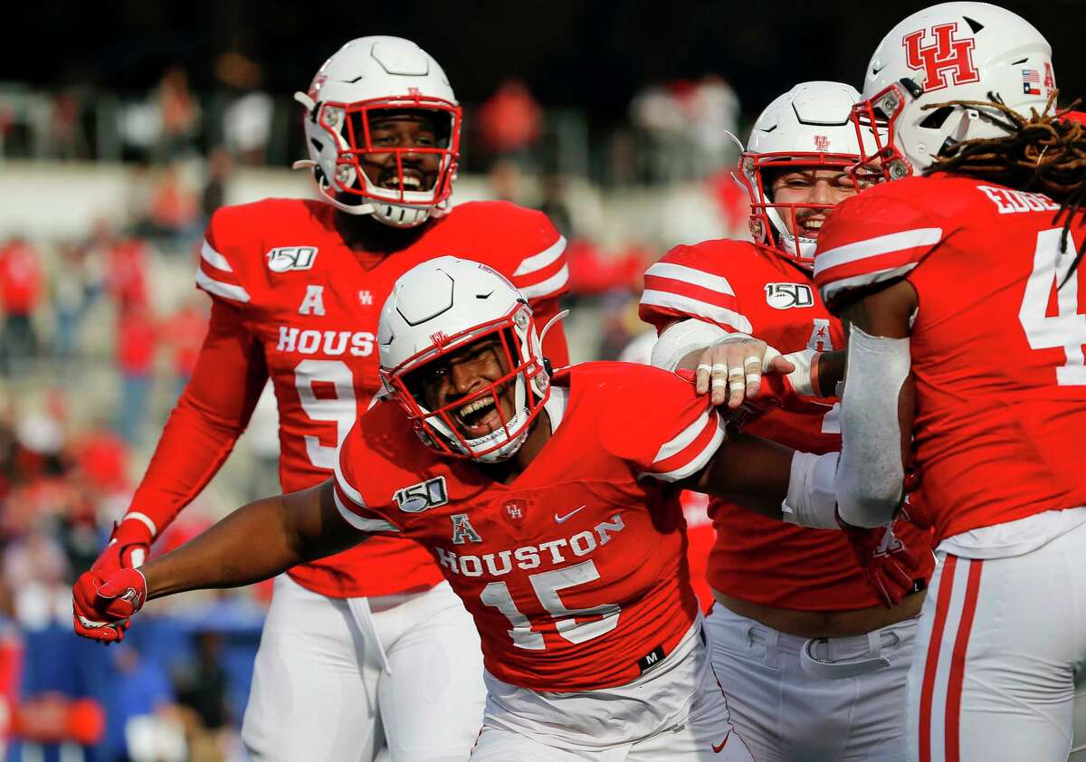 Houston Cougars linebacker Zamar Kirven (15) celebrates after intercepting a pass thrown by Memphis Tigers quarterback Brady White (3) during the first quarter of an NCAA game at TDECU Stadium Saturday, Nov. 16, 2019, in Houston.