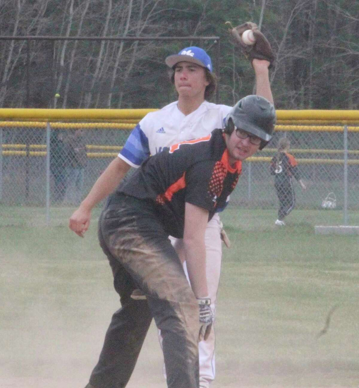Morley Stanwood's Caden Ososkishows the umpire the ball after applyingthe tag at second base to a White Cloud baserunner who is called safe in Saturday's Mohawk Classic. (Pioneer photo/John Raffel)