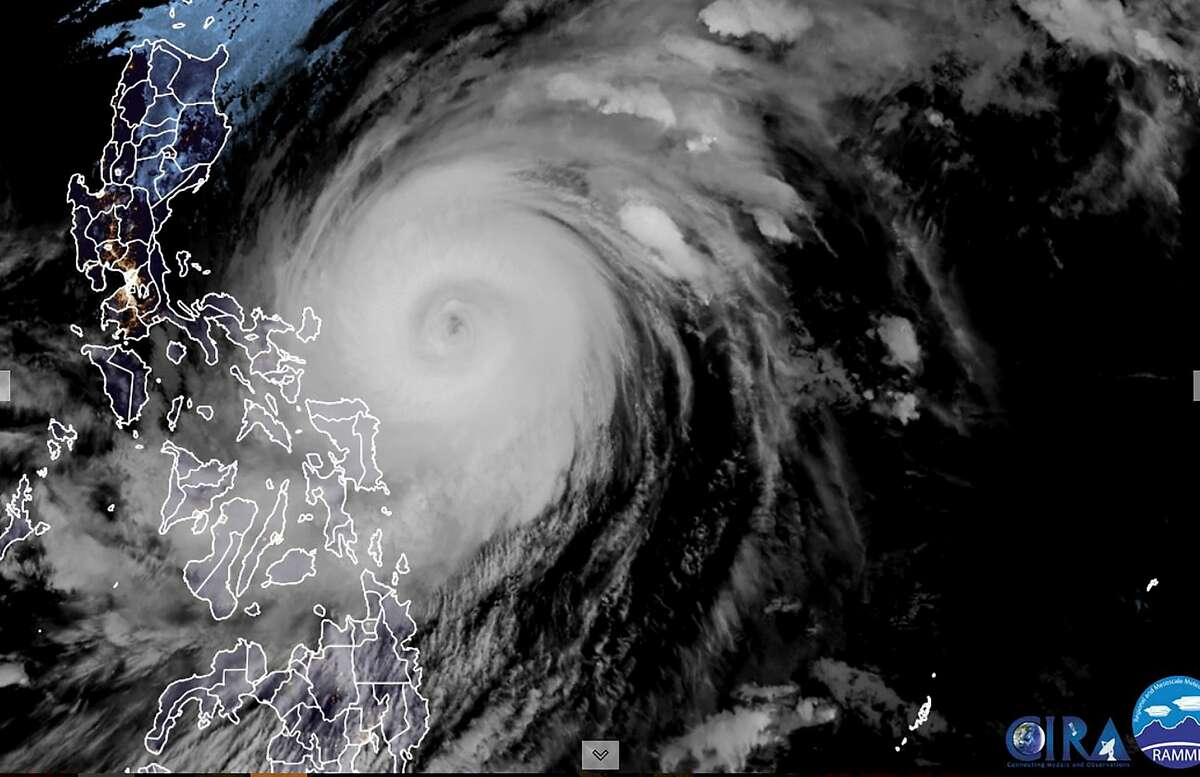 This RAMMB/CIRA handout satellite image shows Super Typhoon Surigae (C) off the eastern coast of the Philippines on April 18, 2021.