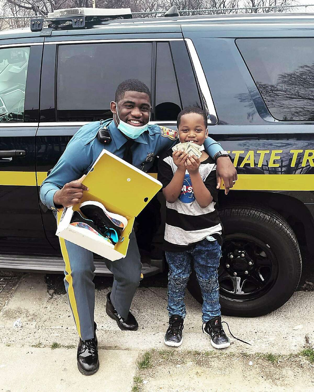 """Delaware State Trooper Joshua Morris and nine-year-old Ra'kir """"Rocky"""" Allen will attend the Golden State Warriors' game against the Philadelphia 76ers Monday, April 19, as guests of Warriors' star Stephen Curry."""