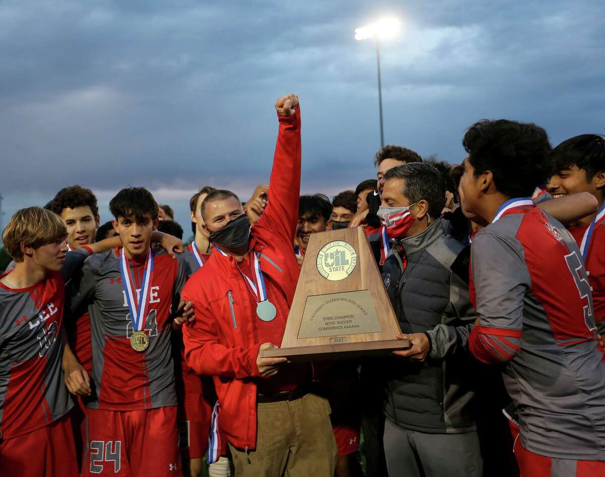 Two years after losing a heartbreaker in the state title game, coach David Rogers, center left, and the Volunteers captured the Class 6A championship.
