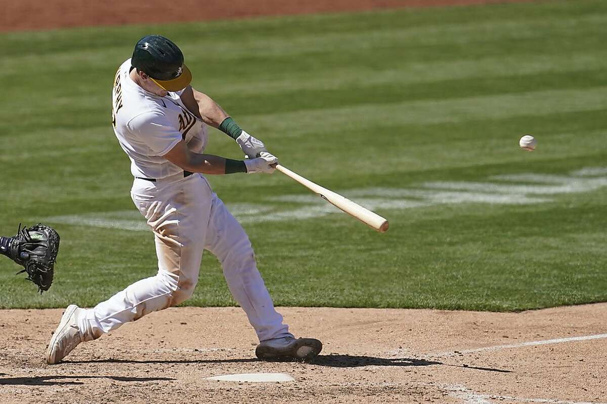 Oakland Athletics' Sean Murphy hits a solo home run against the Detroit Tigers during the eighth inning of a baseball game in Oakland, Calif., Sunday, April 18, 2021.