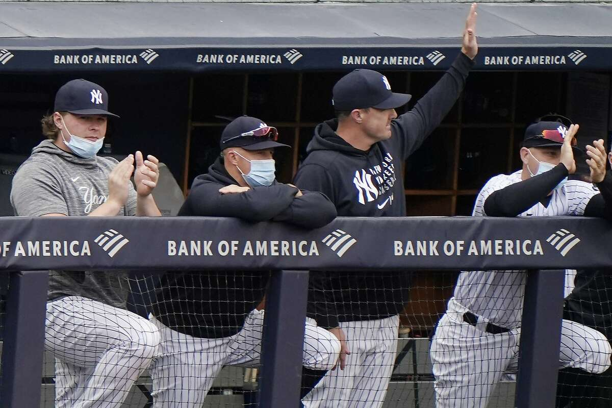 Jay Bruce, a three-time All-Star in 14 major-league seasons, waves from the Yankees' dugout after the team announced his retirement during the seventh inning of a game against the Rays.