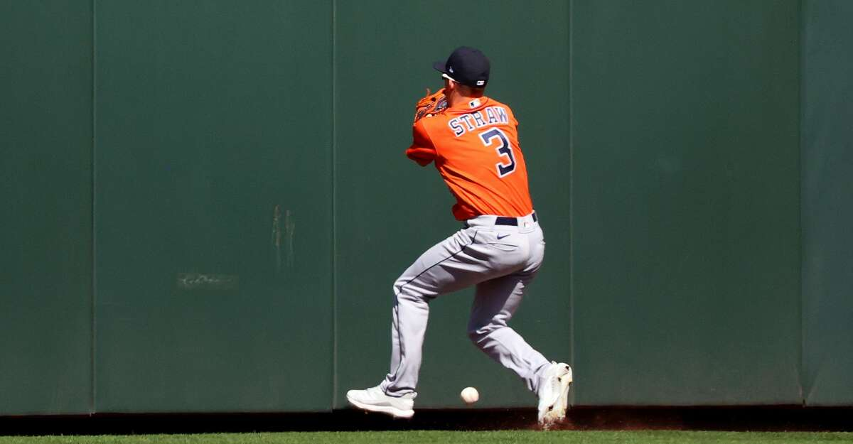 Myles Straw #3 of the Houston Astros is unable to make a catch from a two-run triple by Mitch Haniger #17 of the Seattle Mariners in the fifth inning to give them a 3-2 lead at T-Mobile Park on April 18, 2021 in Seattle, Washington. (Photo by Abbie Parr/Getty Images)