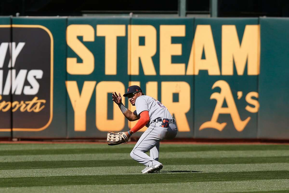 Center fielder Victor Reyes #22 of the Detroit Tigers loses the ball in the sun allowing a double by Matt Olson #28 of the Oakland Athletics in the bottom of the ninth inning at RingCentral Coliseum on April 18, 2021 in Oakland, California.