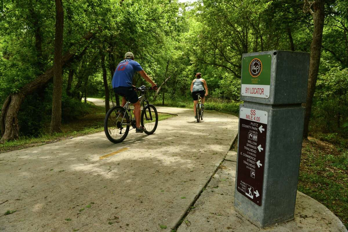 Cyclists ride on the Salado Creek Greenway near the Jack White Trailhead on Sunday afternoon. Local officials say proposed funding from a massive infrastructure bill in Congress could expand the park network.