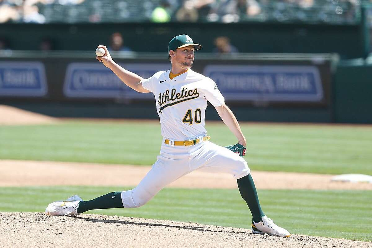 OAKLAND, CALIFORNIA - APRIL 18: Chris Bassitt #40 of the Oakland Athletics pitches in the top of the third inning against the Detroit Tigers at RingCentral Coliseum on April 18, 2021 in Oakland, California. (Photo by Lachlan Cunningham/Getty Images)