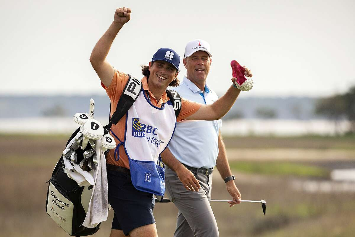 Stewart Cink's son and caddie, Reagan, Cink celebrates his father's win at the RBC Heritage in South Carolina.