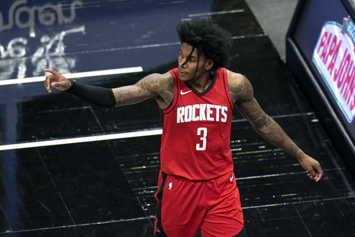 Houston Rockets guard Kevin Porter Jr. (3) points to teammates as he leaves the court after fouling out during the second half of an NBA basketball game against the Orlando Magic, Sunday, April 18, 2021, in Orlando, Fla. (AP Photo/John Raoux)