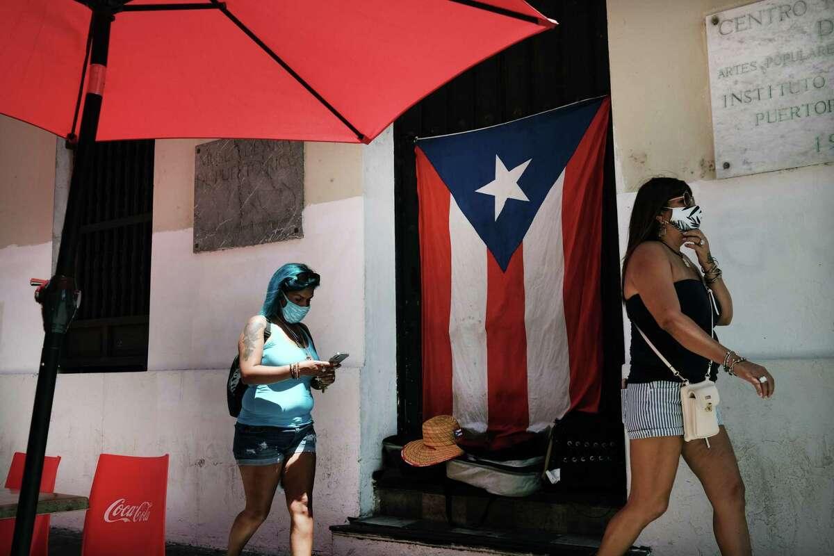 People walk through Old San Juan on March 21, 2021 in San Juan, Puerto Rico.