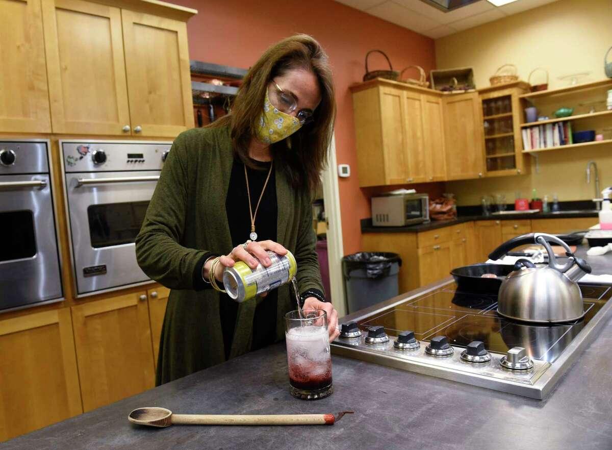 Caroline Barrett makes blackberry switchel at Different Drummer's Kitchen on Tuesday, April 13, 2021 in Albany, N.Y. (Lori Van Buren/Times Union)