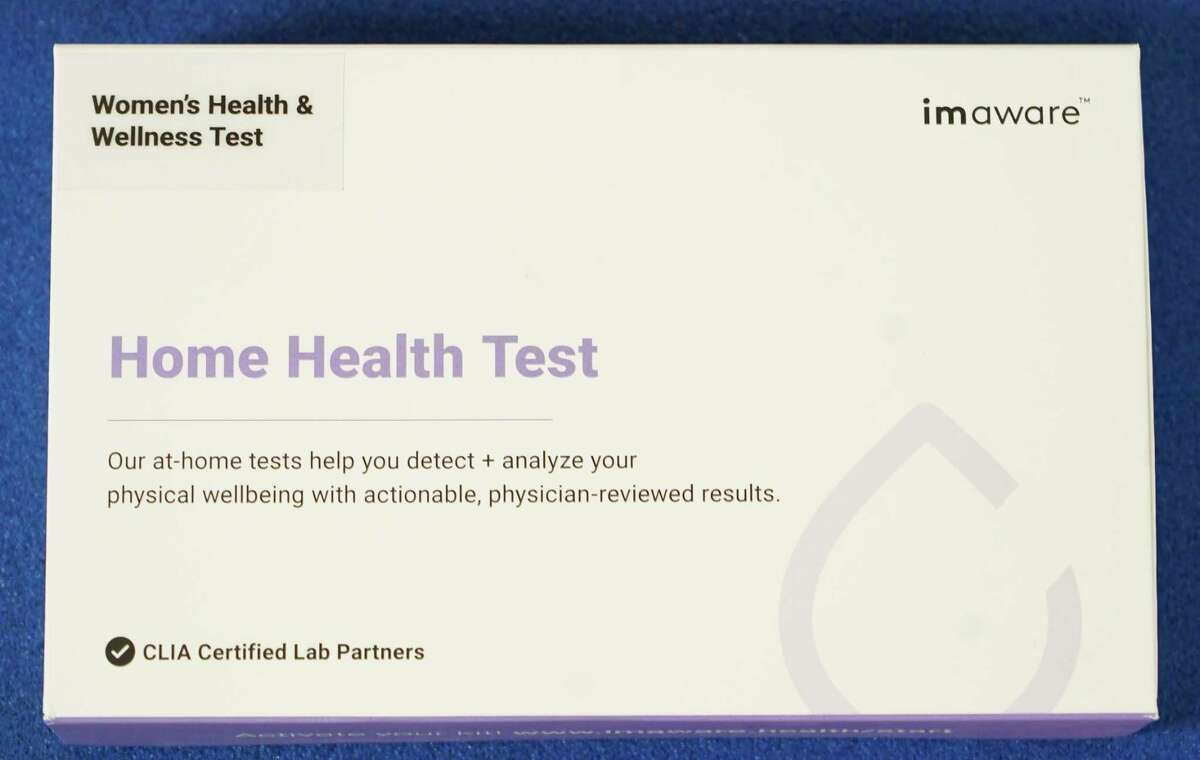 A home blood test kit from imaware is shown at CORE Health and Fitness, 8170 Spring Cypress Rd., owned by Missy Beasley, Friday, April 16, 2021 in Spring. This kit is a women's health and wellness test. She previously took an allergy at-home test.