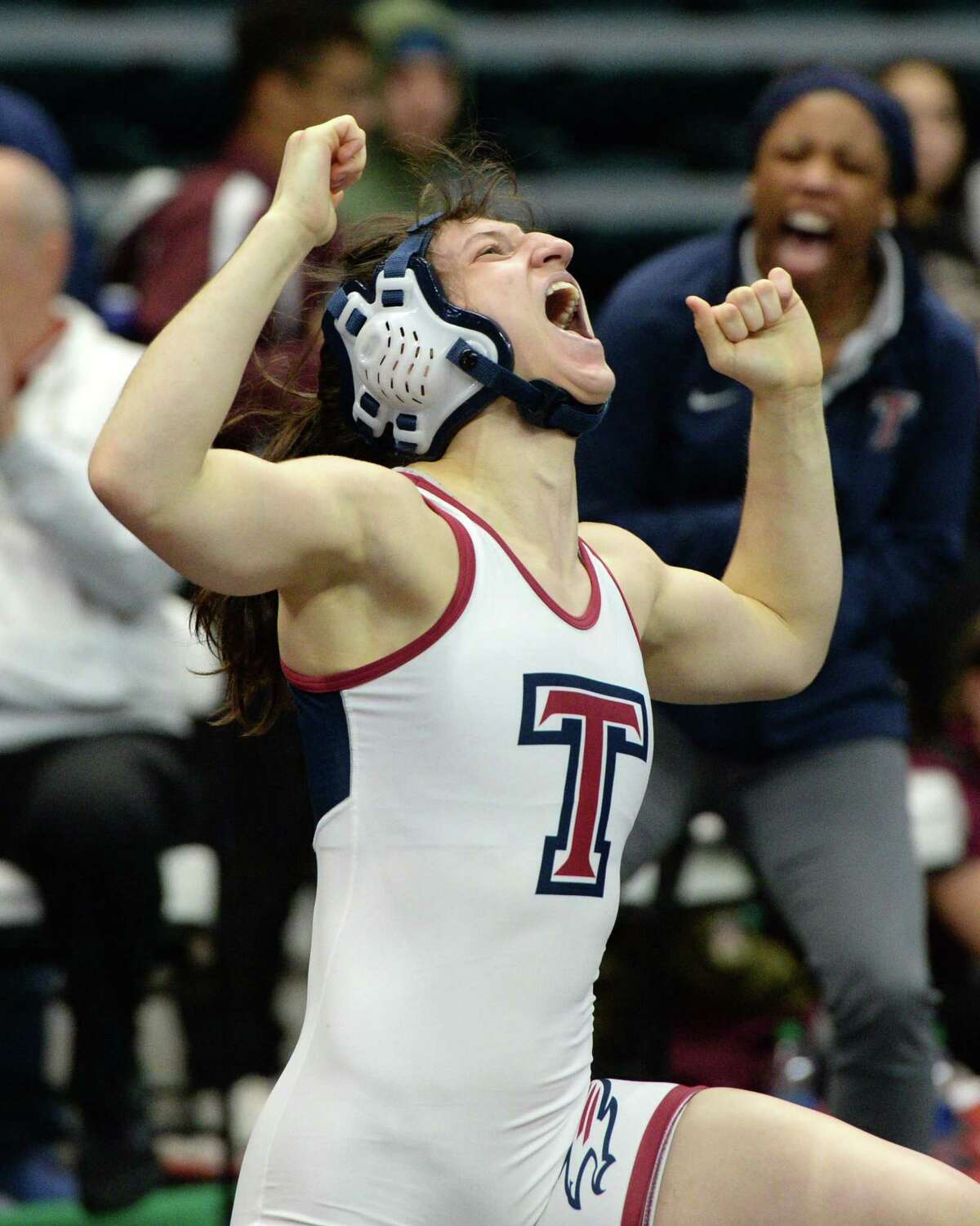 Lilly Broadrick of Katy Tompkins reacts after winning first place in the girls 119 pound weight class during the Region III 6-A UIL Wrestling Championships on Saturday February 15, 2020 at the Leonard Merrell Center, Katy, TX.