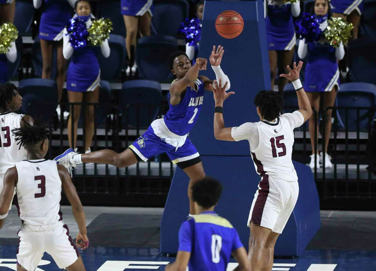 Elkins guard Jacolbi Harris (2) tries to make a pass during the fourth quarter of a UIL 6A Region III Boys Basketball Playoffs Semifinal game against Summer Creek Tuesday, March 2, 2021, at Delmar Fieldhouse in Houston.